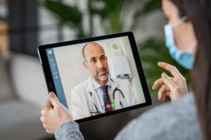 Sick patient in video conference with doctor
